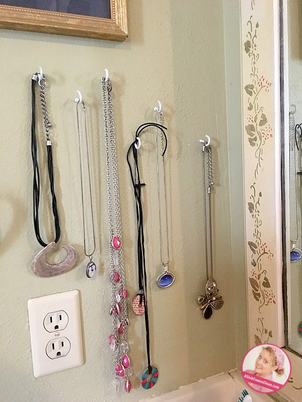necklace organizing solution when decluttering the bathroom drawer at ASlobComesClean.com