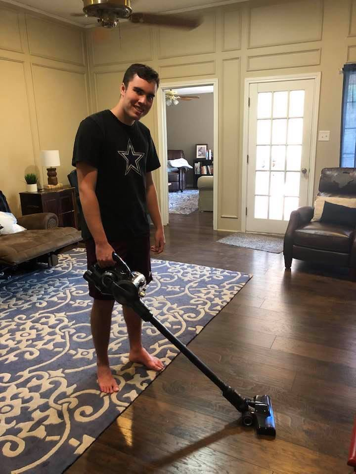 teenager vacuuming with Hoover